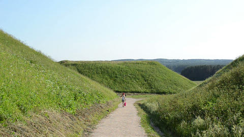 tourist woman walk mound hills in historic capital Kernave Footage