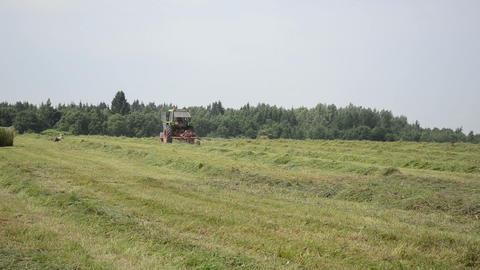 field work equipment tractor hay shaker work outside Footage