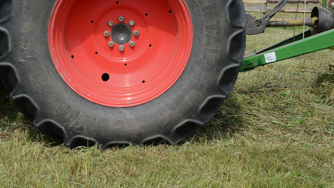 Closeup special tractor equipment collect hay in field Footage