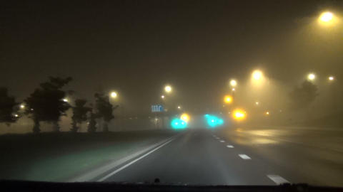 car moving the dense early morning fog blinking traffic light Footage