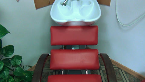 chair and head hair wash basin sink at barber hairdresser salon Footage