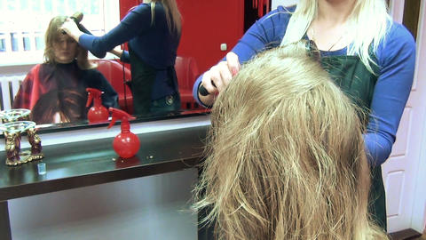 hairdresser barber blow dry customer woman hair in barber salon Footage