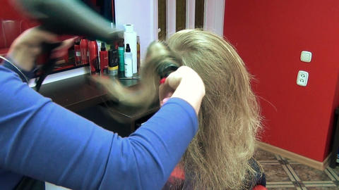 closeup hairdresser barber blow dry customer woman hair Footage