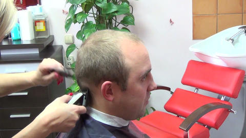 Barber hand cutting customer man head hair with clipper in salon Footage