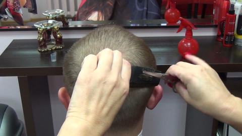 barber cutting fast professional hair with scissors and comb Footage