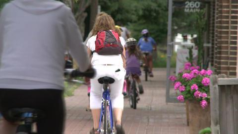 Riding bikes through town (3 of 7) Footage
