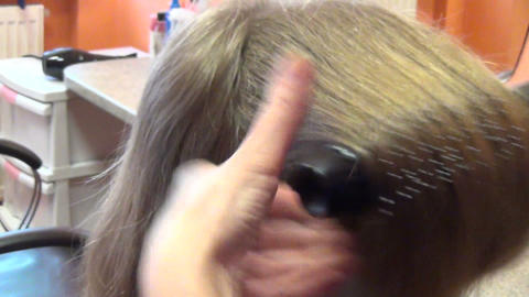 Zoom out customer woman head and hairdresser make hair dress Footage