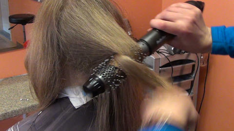 customer girl head closeup and hairdresser make hair dress Footage