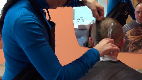 professional hairdresser cut client man hair with scissors Footage