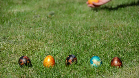 Traditional family Easter game with painted colorful eggs Footage