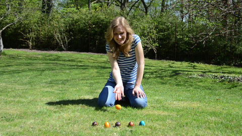 girl have fun playing Easter game with painted colorful eggs Footage