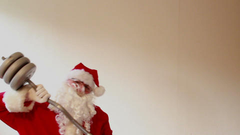 Santa Claus trying lift heavy weights and collapsing - time lapse Footage