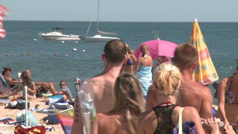 People sunbathing at a sandy beach (2 of 2) Footage