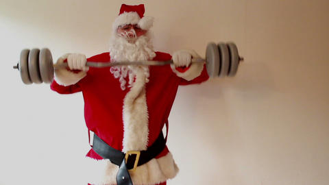 Santa Claus Lifting Weights - Time Lapse stock footage