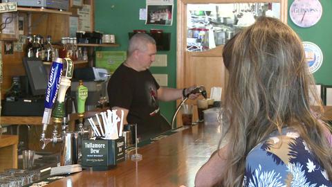 Bartender filling beer on draught Live Action