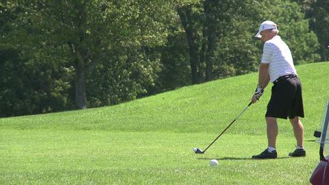 Golfer teeing off (2 of 4) Footage