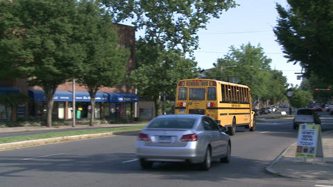 School bus going with flow of traffic (2 of 2) Live Action
