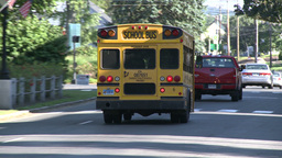 School bus going with flow of traffic (1 of 2) Live Action