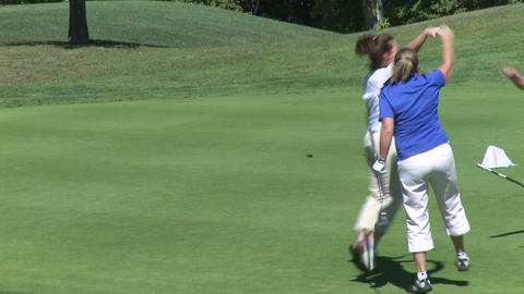 Female golfer sinks putt Footage