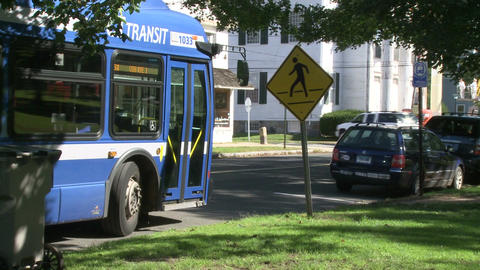 Local Bus Pulling Away From Bus Stop stock footage