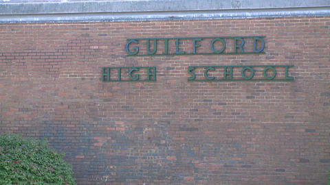 Sign for High School on the side of the school building Footage