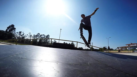 Skateboarder performing an ollie grab Live Action