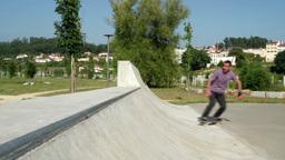 Skateboarder performing a grind Footage