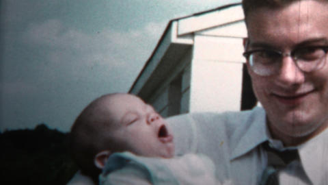 1958 - New Dad Holding Baby Versus Grandpa Holding Baby Footage