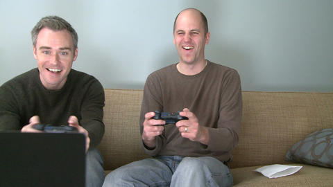 Two men playing a video game in the living room (5 of 5) Footage