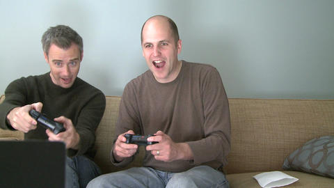 Two men playing a video game in the living room (3 of 5) Footage
