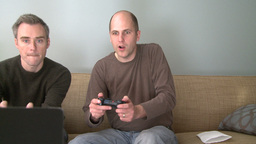 Two men playing a video game in the living room (1 of 5) Footage