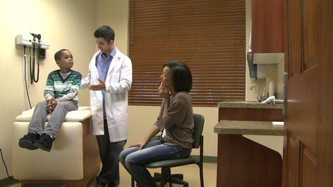 Doctor assists mom and son Footage
