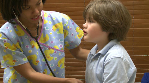 Young boy at doctors office Footage