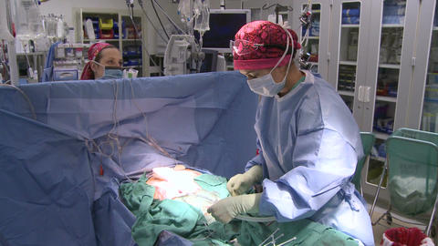 Medical team prepares to begin surgery Footage
