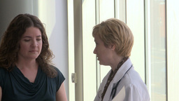 Female doctor comes in to speak to her female patient (2 of 5) Live Action