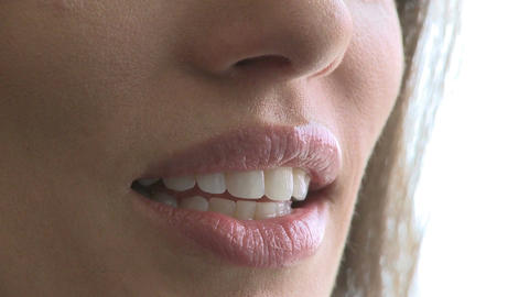 Closeup of woman's mouth as she converses (2 of 3) Footage