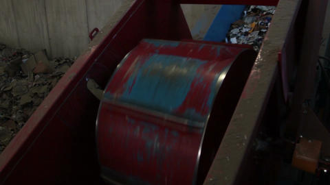A Large Drum Crushing Cans at a Recycling Center (2 of 2) Footage