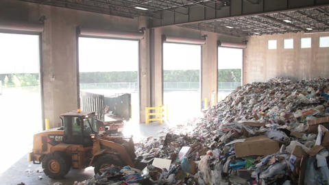 A Front End Loader Moves Trash at a Recycle Center ( 1 of 9) Footage