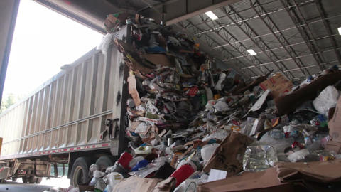 A Truck Dumps Trash to be Recycled (10 of 10) Footage