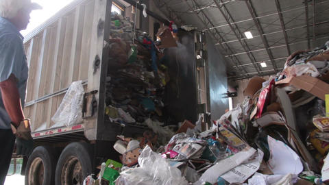 A Truck Dumps Trash to be Recycled (5 of 10) Footage