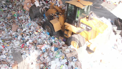 A Front End Loader Moves Trash at a Recycle Center ( 4 of 9) Footage