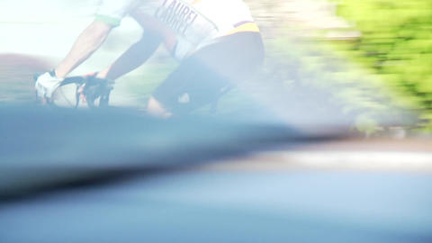 Close-up of cyclist riding through town Footage