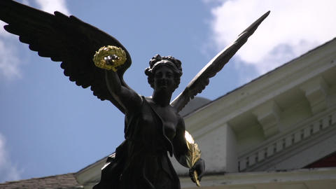 Statue of woman with wreath and wings (3 of 4) Footage