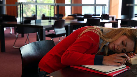 Mature student sleeping at study table Footage