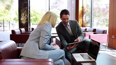 Business people using digital tablet in meeting Footage