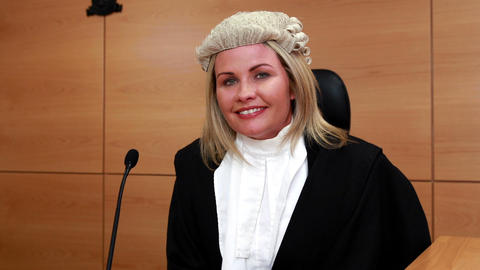 Portrait of a smiling judge wearing robes and wig Footage