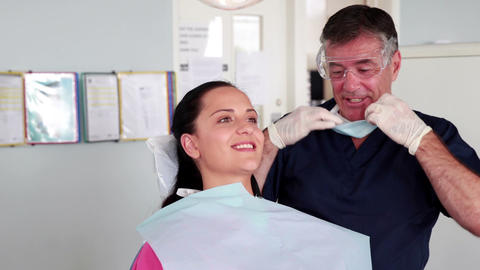 Smiling dentist examining a patient Footage