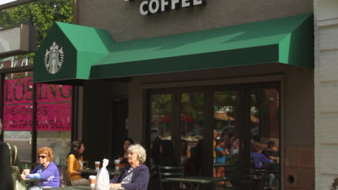 Women sitting outside Starbucks Footage