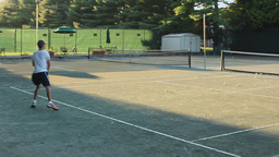Two people playing tennis Footage