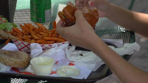 Eating a burger and fries outside (1 of 2) Live Action